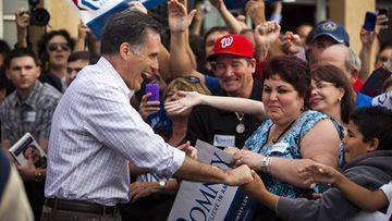 Republican presidential candidate Mitt Romney greets supporters outside the Casa Marin Restaurant in Hialeah, Florida, USA 29 January 2012.