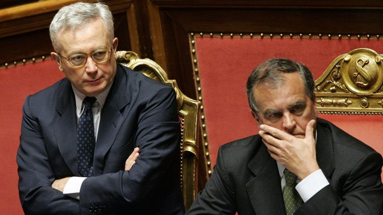 Italian Economy Minister, Giulio Tremonti sits arms folded next to Minister for Simplication Rules Roberto Calderoli during the debate in the Senate, Rome 14 July 2011 ahead of the vote on a tough austerity budget which proposes cuts of 48 billion euros over three years.