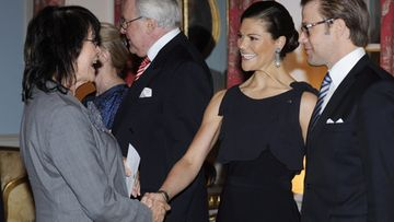 Business woman Liisa Lipsanen greeting Crown Princess Victoria and Prince Daniel of Sweden during reception at the Swedish Embassy in Helsinki, 2nd of Nov. 2010.