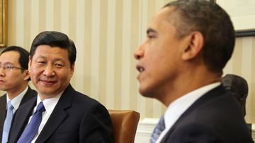 US President Barack Obama (right) meets with Vice President Xi Jinping of the People's Republic of China in the Oval Office of the White House, Washington, DC, Feb. 14, 2012.