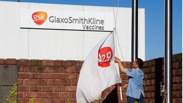A security guards hoists a GlaxoSmithKline (GSK) company flag outside the GSK factory in Shanghai, China, 17 July 2013. Chinese media reports citing Chinese commerce officials said that an investigation against British drugmaker GlaxoSmithKline (GSK) was 'part of the country's efforts to improve business climate and create equal competition opportunities for domestic and overseas investors'. Pharmaceutical company GSK has been accused by China of bribing local doctors so that they prescribe GSK-made drugs.