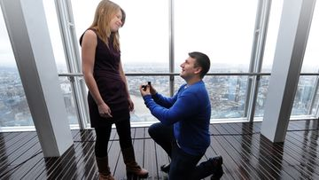 ames Episcopou, 22 from Essex, gets on one knee to propose to his long time girlfriend Laura Taylor, 22, also from Essex following the opening of The Shard in London, Britain, 01 February 2013. Laura said 'Yes'. The London Mayor Boris Johnson earlier cut a ribbon at 244 meters above the capital to welcome visitors to Europe's tallest building.