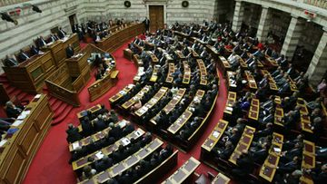 Greek Prime Minister Antonis Samaras (L) speaks to the plenum prior to a voting of the Greek Parliament for the 2013 Budget, in Athens, Greece, 11 November 2012. Greece's parliament on 11 November met to vote on the 2013 budget, a hurdle to securing the next international bailout tranche. The government is expected to win the midnight (2200 GMT) vote with a comfortable margin after a much tougher bill on spending cuts passed with 153 votes in the 300-member legislature la week before
