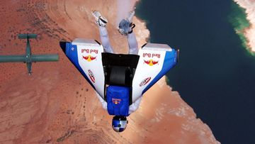 Austrian extreme sky-diver Felix Baumgartner is airborne as he flies in a man-against-machine race through the skies above Lake Powell on the Utah-Arizona border with a carbon wing strapped to his back as part of the 'Taurus World Stunt Award'.