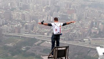 Austrian Base-Jumper Felix Baumgartner, 38, leaps off the world's tallest building, the 509-meter high Taipei 101 Tower, Taiwan, 11 December 2007.