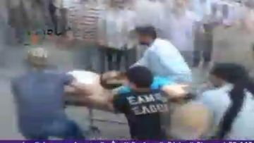 A TV grab taken from Al Arabiya channel on 01 August 2011 shows Syrian protesters carrying an injured man following attacks by the Syrian army on the city of Hama, Syria.