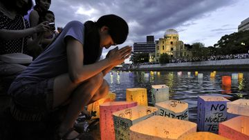 A woman prays after floating a paper lantern on the Motoyasu River to honour the victims of the world's first atomic bombing in Hiroshima, Japan, 06 August 2011, to mark the 66th anniversary of the 1945 atomic bombing.