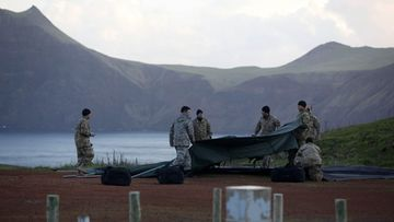 Members of Chilean Air Force build a tent during the search works the day after a military aircraft crashed in the Juan Fernandez archipelago, 670 kilometers from chilean coasts, on 03 September 2011.