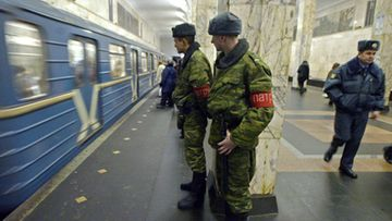 A file picture dated 09 February 2004 shows Russian military servicemen on patrol at the 'Avtozavodskaya' subway station in Moscow, Russia. At least 25 people were killed early 29 March 2010 in an explosion in Moscow's metro, the Itar-Tass news agency reported. The cause of the blast remained unclear.  EPA/SERGEI CHIRIKOV
