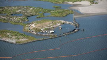 a containment boom staged at the Breton National Wildlife Refuge on 29 April 2010 as part of the preventive measures being taken to keep the Gulf oil spill from reaching the coastlines.