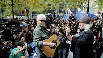 British singer-songwriter Graham Nash (L) and US singer-songwriter David Crosby (R) perform a small concert in Zuccotti Park at the Occupy Wall Street encampment in New York, New York, USA, 08 November 2011.