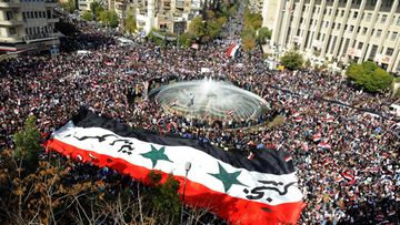 A handout picture released by Syrian news agency SANA shows tens of thousands of Syrians flocked in Sabe Bahrat square in downtown Damascus, Syria on 13 November 2011 to express anger over the Arab League's decision taken 12 November to suspend Syrias membership citing Syria's alleged failure to end a deadly crackdown on civilian protests.