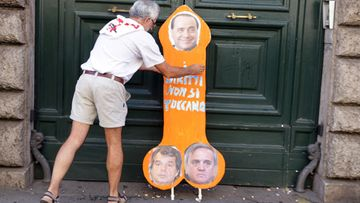 A cardboard cutout of a male organ with pictures of Italian Prime Minister Silvio Berlusconi (top); Maurizio Sacconi (R-bottom), Minister of Labour and Social Affairs and Renato Brunetta, Minister of Public Administration and Innovation leans on the door of the Ministry of Public Administration during a general strike, Rome, Italy, 06 September 2011.