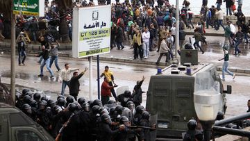 Egyptian anti-riot policemen are deployed to separate between opponents and supporters of President Mohamed Morsi during clashes over the disputed draft constitution in Alexandria, Egypt, 21 December 2012. Islamist backers of President Mohamed Morsi and opponents clashed on 21 December outside a mosque in the Egyptian city of Alexandria, a day before the final phase of vote on the disputed draft constitution. Riot police fired tear gas to end the violence, which left at least five people injured.