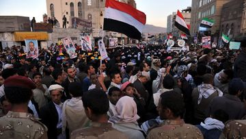 Yemeni soldiers block protesters during a march demanding the restructuring of the military and security units in Sana'a, Yemen, 06 December 2012. Reports state thousands of Yemenis took to the streets in Sana'a to demand the major restructuring of their country's military and security services, which suffer a high number of defections, as well as the ousting of former president Ali Saleh's relatives who control most of the military and security agencies.