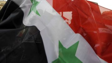 Lebanese and Syrians living in Lebanon carry Syrian flags during a demonstration in support of the Syrian regime in downtown Beirut, Lebanon, 22 February 2012. At least 51 people, including two Western journalists, were killed on 22 February by government troops across Syria, the opposition Syrian Local Coordination Committee (LCC) reported. Most of the deaths occurred in the province of Homs, while others were killed in the provinces of Idlib and Hama, according to the LCC. EPA/WAEL HAMZEH