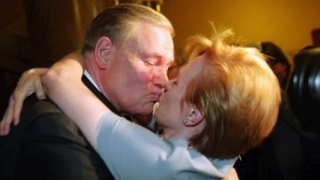 20030316 - HELSINKI, FINLAND: Prime Minister, Chairman of the Social Democratic party Paavo Lipponen gets a hug from his wife Paivi in the election wake in Helsinki March 16. Social Democrats captured 24.5 percent of the vote.