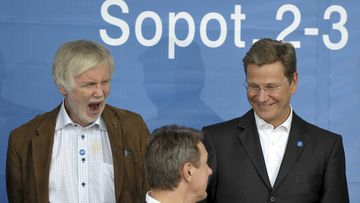 Finland's Foreign Minister Erkki Tuomioja (L) yawns as with German Foreign Minister Guido Westerwelle (R) they pose for a family photo at the informal meeting of EU foreign ministers starts in the Baltic resort of Sopot, Poland, 02 September 2011