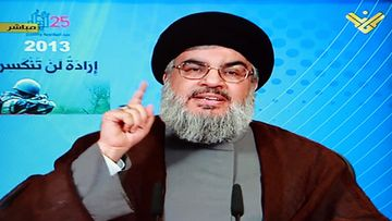 A TV grab from Al-Manar television shows Hezbollah Secretary-General Sayyed Hassan Nasrallah speaking during a rally to mark the Resistance and Liberation Day in the village of Mashghara in the eastern Bekaa valley Lebanon 25 May 2013. The Liberation Day commemorates the Israeli army's withdrawal from south Lebanon in May 2000.