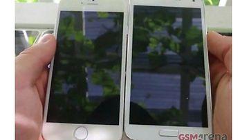 Väitetty vuotokuva iPhone 6 -mallista (vasemmalla) Galaxy S5 -puhelimen vierellä. Kuvakaappaus GSMArena-sivustolta