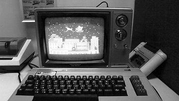 Valmiiksi ohjelmoituja joulukuvia joulun myyntivaltin, kotitietokoneen (Commodore 64), näyttöruudulla.