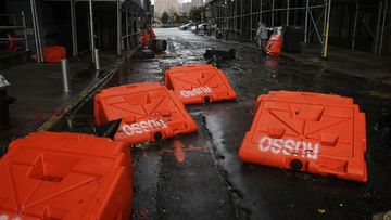 NEW YORK, NY - OCTOBER 30: Portable upended flood dikes are viewed on a flooded street in the Dumbo section of Brooklyn after the city awakens to the affects of Hurricane Sandy on October 30, 2012 in New York, United States. At least 15 people were reported killed in the United States by Sandy as millions of people in the eastern United States have awoken to widespread power outages, flooded homes and downed trees. New York City was his especially hard with wide spread power outages and significant flooding in parts of the city. (Photo by Spencer Platt/Getty Images)