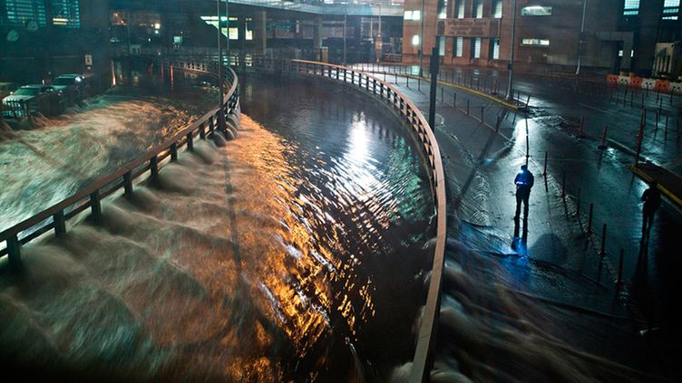 NEW YORK, NY - OCTOBER 29: Water rushes into the Carey Tunnel (previously the Brooklyn Battery Tunnel), caused by Hurricane Sandy, October 29, 2012, in the Financial District of New York, United States. Hurricane Sandy, which threatens 50 million people in the eastern third of the U.S., is expected to bring days of rain, high winds and possibly heavy snow. New York Governor Andrew Cuomo announced the closure of all New York City will bus, subway and commuter rail service as of Sunday evening (Photo by Andrew Burton/Getty Images)