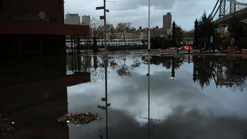 EW YORK, NY - OCTOBER 30: A flooded street in the Dumbo section of Brooklyn is viewed after the city awakens to the affects of Hurricane Sandy on October 30, 2012 in New York, United States. At least 15 people were reported killed in the United States by Sandy as millions of people in the eastern United States have awoken to widespread power outages, flooded homes and downed trees. New York City was his especially hard with wide spread power outages and significant flooding in parts of the city. (Photo by Spencer Platt/Getty Images)