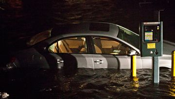 NEW YORK, NY - OCTOBER 29: Flooded cars, caused by Hurricane Sandy, are seen on October 29, 2012, in the Financial District of New York, United States. Hurricane Sandy, which threatens 50 million people in the eastern third of the U.S., is expected to bring days of rain, high winds and possibly heavy snow. New York Governor Andrew Cuomo announced the closure of all New York City will bus, subway and commuter rail service as of Sunday evening (Photo by Andrew Burton/Getty Images)
