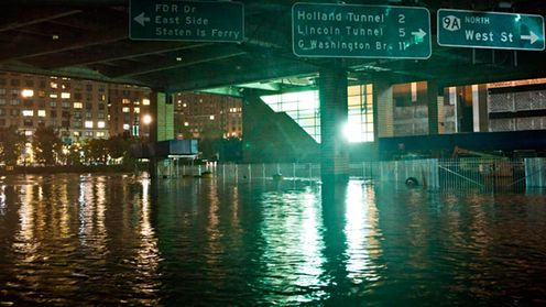 NEW YORK, NY - OCTOBER 29: A flooded street, caused by Hurricane Sandy, is seen on October 29, 2012, in the Financial District of New York, United States. Hurricane Sandy, which threatens 50 million people in the eastern third of the U.S., is expected to bring days of rain, high winds and possibly heavy snow. New York Governor Andrew Cuomo announced the closure of all New York City will bus, subway and commuter rail service as of Sunday evening. (Photo by Andrew Burton/Getty Images)