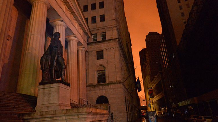 A view of a statue of George Washington on Wall Street after Hurricane Sandy left most of lower Manhattan without power in New York, New York, USA, 30 October 2012. The storm is one of the largest to hit the region in decades and threatens to cause massive problems for millions of people. EPA/JUSTIN LANE