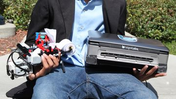 Shubham Banerjee holding Braigo v1.0 and v2.0 2