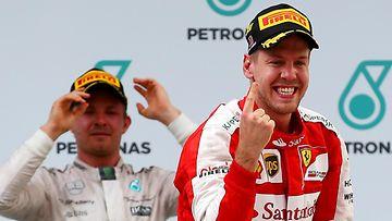 Sebastian Vettel, Nico Rosberg, 2015 (1)