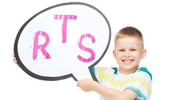 Poika, puhekupla ja kirjaimia