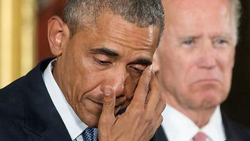 obama kyyneleet aselaki