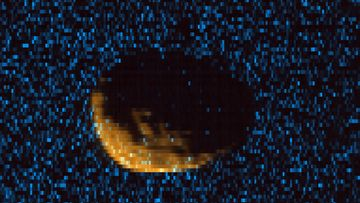 Phobos as observed by MAVEN's Imaging Ultraviolet Spectrograph. Orange shows mid-ultraviolet (MUV) sunlight reflected from the surface of Phobos, exposing the moon's irregular shape and many craters. Blue shows far ultraviolet light detected at 121.6 nm, which is scattered off of hydrogen gas in the extended upper atmosphere of Mars. Phobos, observed here at a range of 300km, blocks this light, eclipsing the ultraviolet sky.