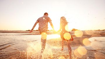 parisuhde auringonlasku ranta