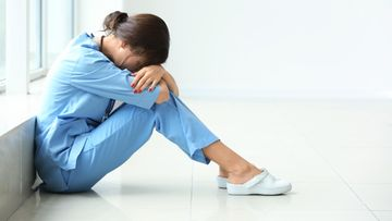 väsynyt sairaanhoitaja