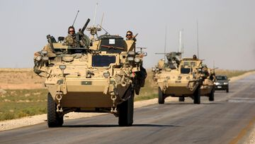 LK: Syyrialainen poika katsoo amerikkalaista panssarivaunua