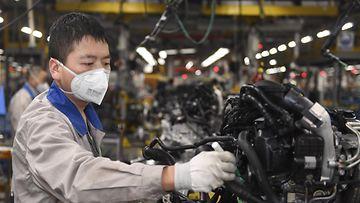 kiina koronavirus autotehdas