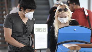 LK, 11.8.20, korona, koronavirus, lentokenttä, lentoasema, kasvomaski, maski, hengityssuojain