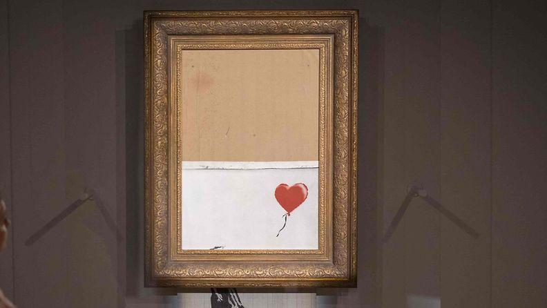 LK 65932318 Osittain silputtu Banksyn teos myytiin ennätyssummalla Lontoossa