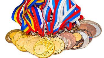 Rahan mukaan tulo muutti olympialaisten luonnetta. Kuvan mitalit eivät liity olympialaisiin.